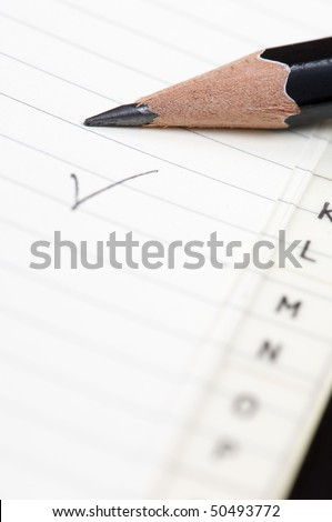 black wooden pen on a phone book - stock photo