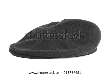 Black woven beret flat-crowned hat isolated over the white background - stock photo