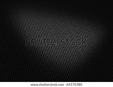 Black woven carbon fibre surface curved form soft shadows - stock photo