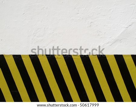Black & Yellow parking lot zebra pattern on white wall (background resources)