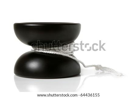 Black yo-yo toy on a white background - stock photo