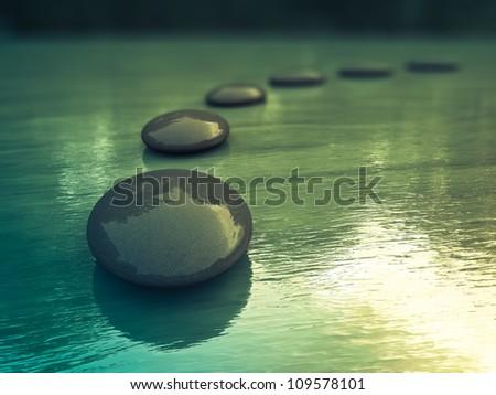 Black zen stones  on a sea - stock photo