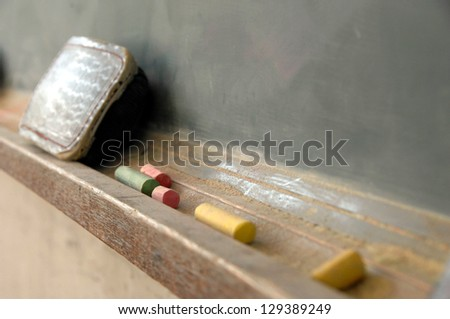 Blackboard and chalkes after school - stock photo