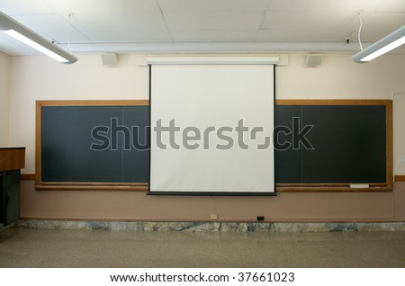 Blackboard and projector screen - stock photo
