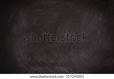 Blackboard  chalkboard texture. Empty  black  with chalk traces - stock photo
