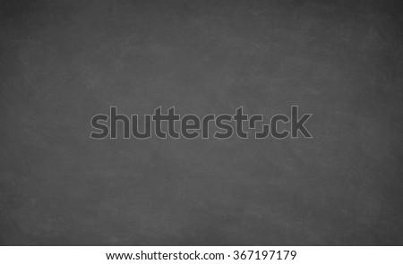 Blackboard, chalkboard texture. Empty blank black board with chalk traces - stock photo