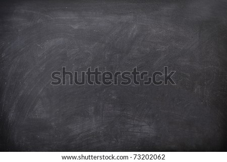 Blackboard / chalkboard texture. Empty blank black chalkboard with chalk traces - stock photo