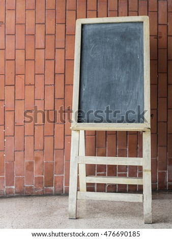 Blackboard  easel,stand on the brick background coffee shop.
