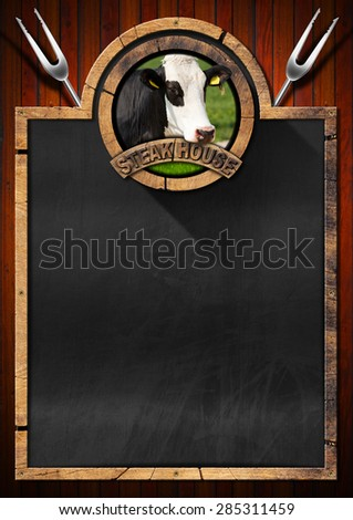 Blackboard for a Steak House / Empty blackboard with wooden frame, symbol of a steak house with head of cow and two forks. Template for a meat menu - stock photo
