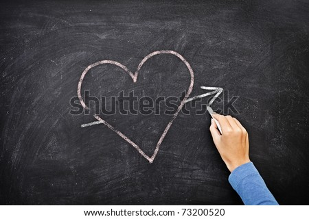 Blackboard heart - love concept. Hand drawing heart with chalk on chalkboard. - stock photo