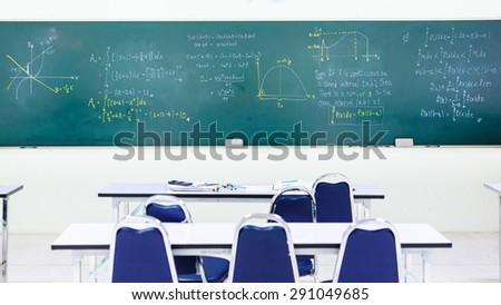 Blackboard in the math classroom - stock photo