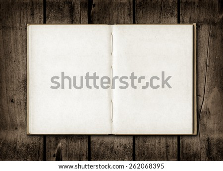 Blackboard on a old dark wood wall background texture - stock photo