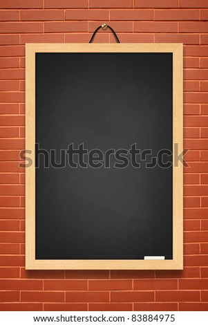 Blackboard on brown wall background - stock photo
