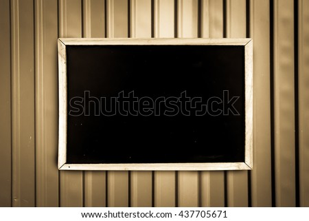 blackboard on metal sheet background