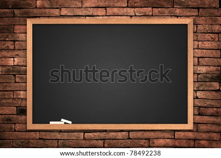blackboard on wall Brick mortar background - stock photo