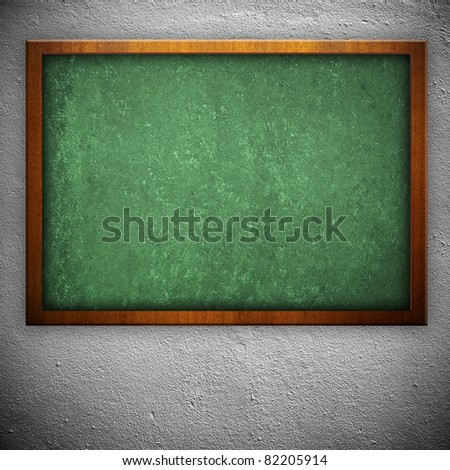 blackboard on white wall - stock photo
