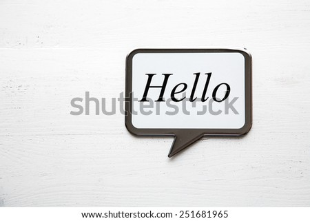 Blackboard on white wooden table shaped cloud with place for writing texts - stock photo