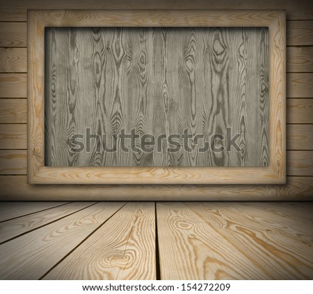 Blackboard on wooden wall background