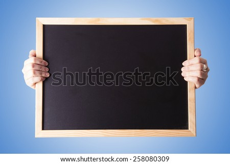 blackboard over blue background - stock photo