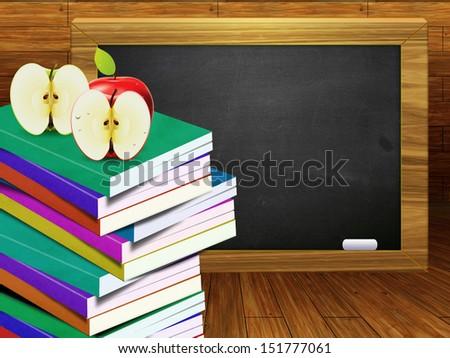 Blackboard, school books and apples on wood background. - stock photo