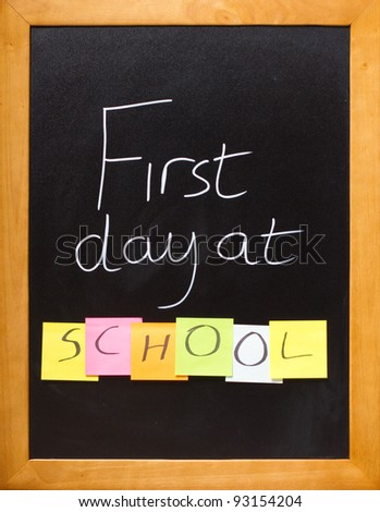 Blackboard showing a fun first day at school message - stock photo