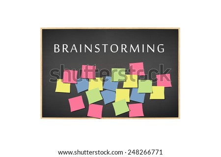 Blackboard with Brainstorming and post it adhesive notes isolated on white background - stock photo
