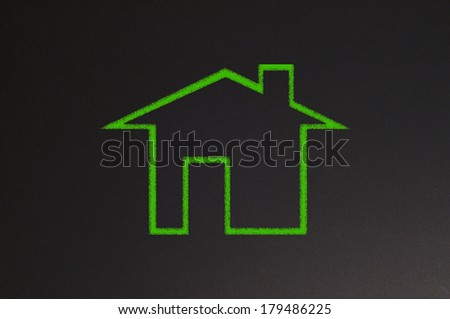 blackboard with chalk draw of house - stock photo