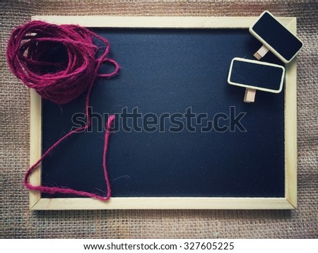 Blackboard with decoration in vintage filter effect - stock photo