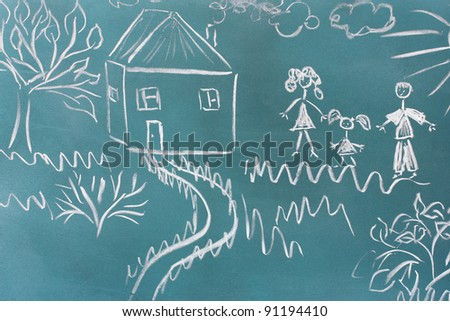 Blackboard with drawing happy family with house closeup - stock photo