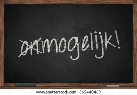 Blackboard with Dutch word for Impossible - stock photo