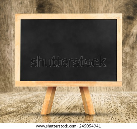 Blackboard with easel on wood floor and blur wood wall,Template for your content. - stock photo