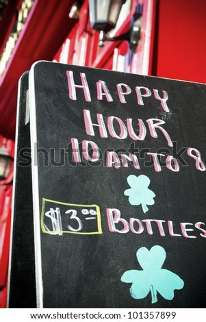 blackboard with happy hours - stock photo