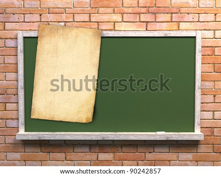 blackboard with old paper for notes on brick wall - stock photo