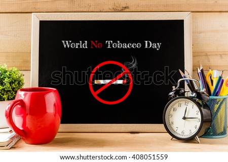 """Blackboard with text inside """"World No Tobacco Day"""" on table coffee . office equipment.Concept World No Tobacco Day. - stock photo"""
