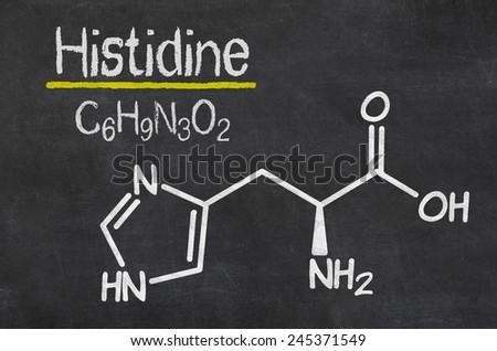 Blackboard with the chemical formula of Histidine - stock photo