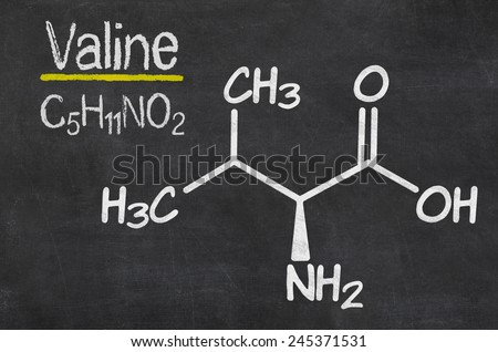 Blackboard with the chemical formula of Valine - stock photo