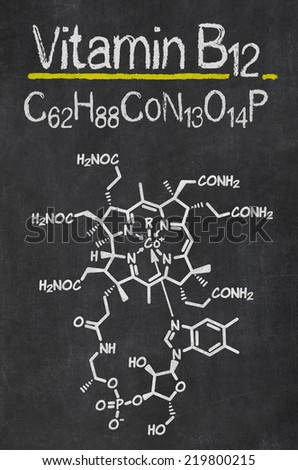 Blackboard with the chemical formula of Vitamin B12 - stock photo