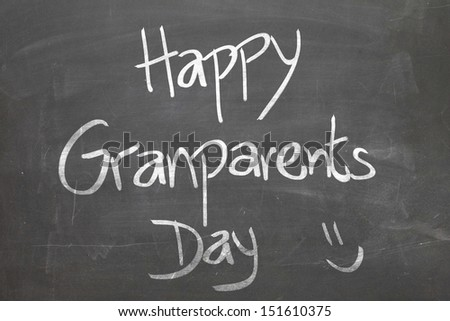 Blackboard with the message - Happy Grandparents Day - stock photo