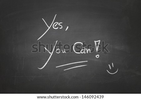 Blackboard with the message - Yes, You Can - stock photo