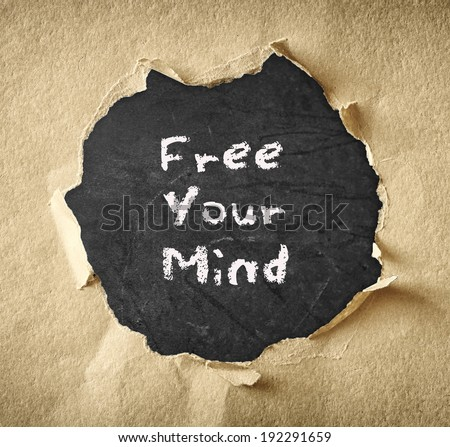 blackboard with the phrase free your mind - stock photo