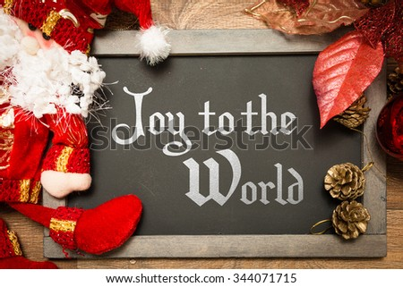 Blackboard with the text: Joy to the World in a christmas conceptual image - stock photo