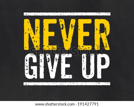 Blackboard with the text Never give up - stock photo