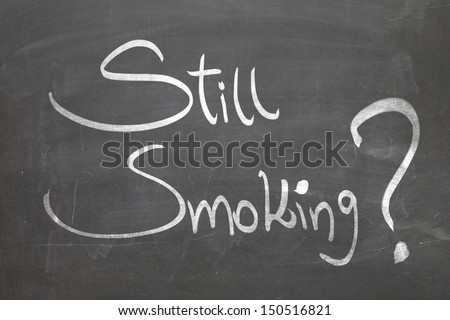 Blackboard with the text Still Smoking - stock photo