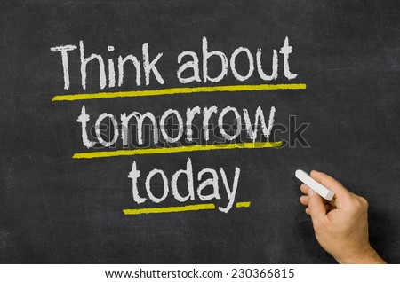 Blackboard with the text Think about tomorrow today - stock photo