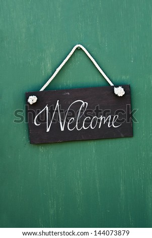blackboard with the words welcome to hang on the door - stock photo