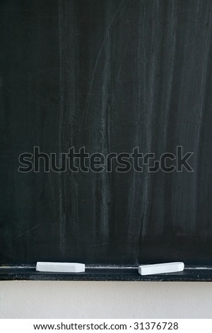 blackboard with two white chalks, detail photo - stock photo