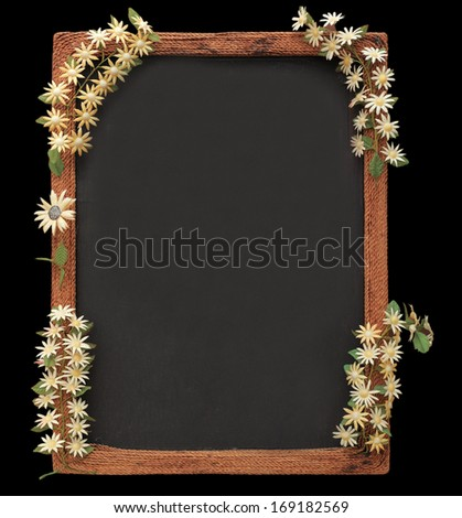 blackboard with wooden frame and flowers made from silk cocoon border isolated on black with work path - stock photo