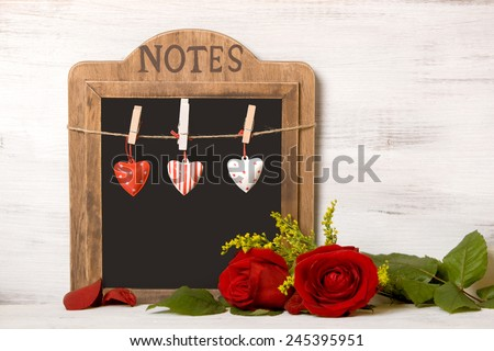 "Blackboard, with writing ""On February 14, Valentine's Day"" on wood wall - stock photo"