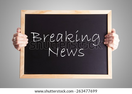blackboard write Breaking News - stock photo