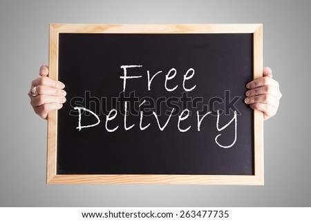blackboard write Free Delivery - stock photo